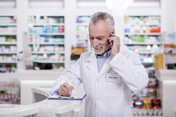 pharmacist answering questions for senior